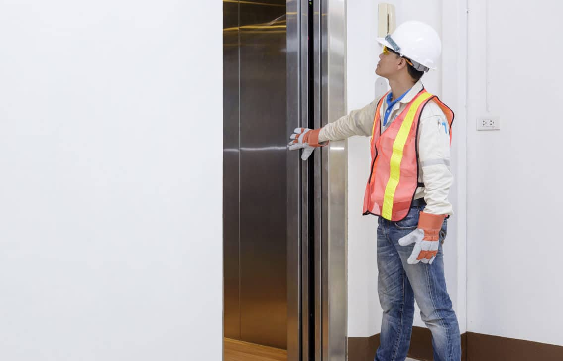 Engineer investigating an elevator